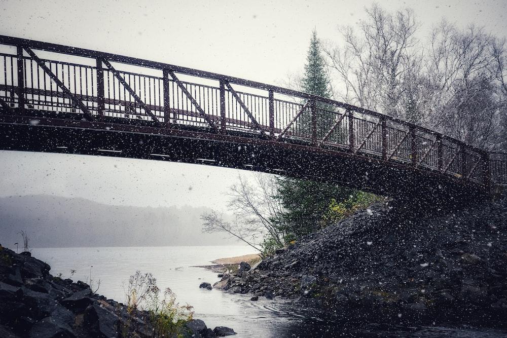 black metal bridge over river