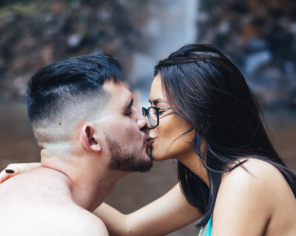 man kissing womans forehead