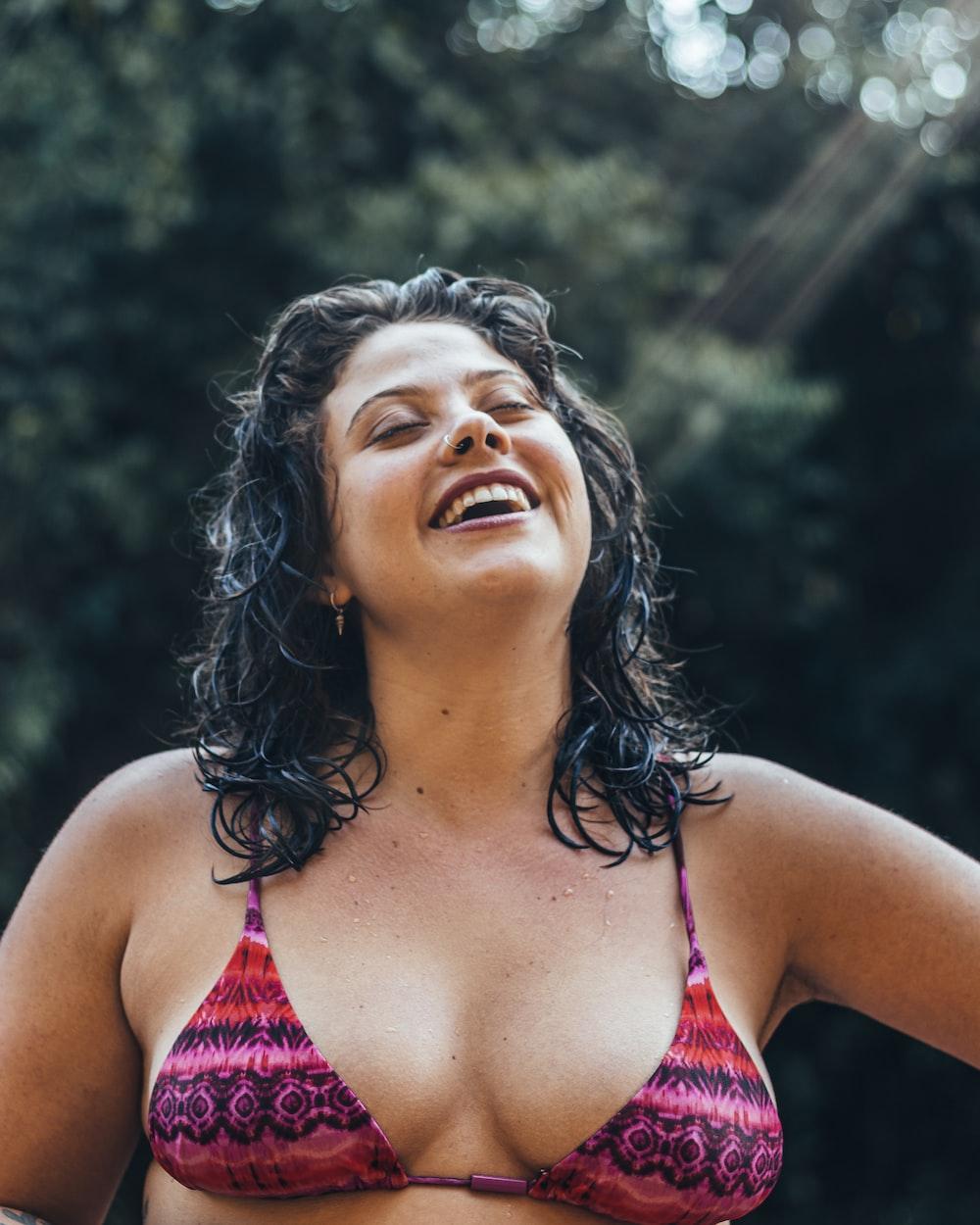 woman in pink and white bikini top