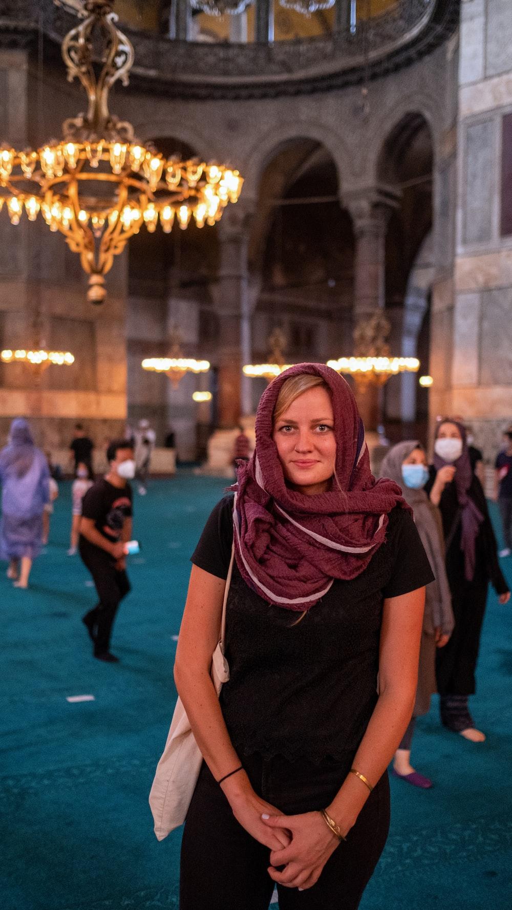 woman in black shirt and purple hijab