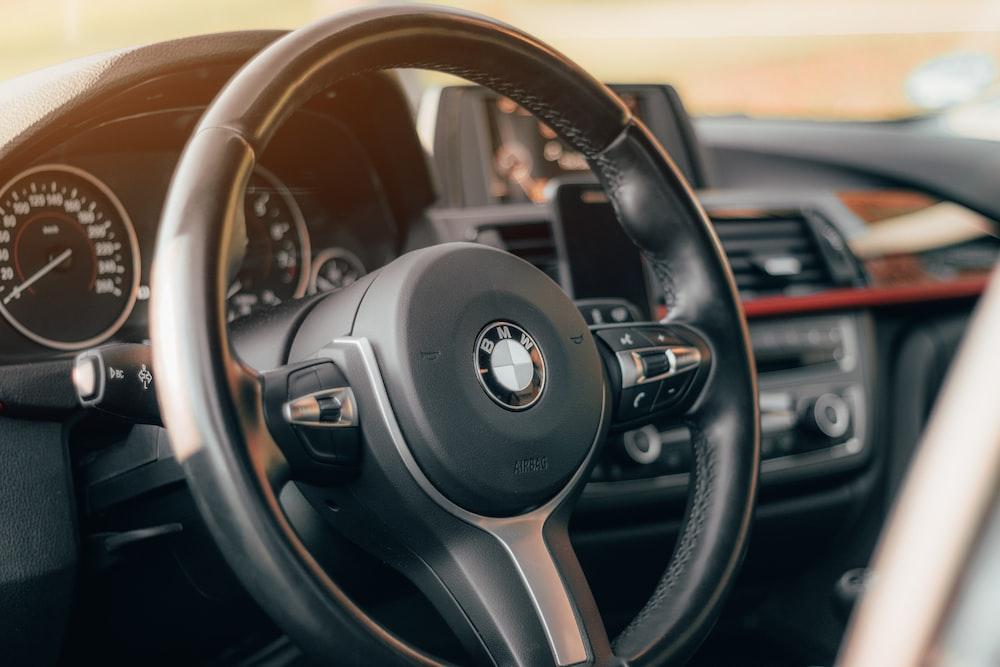 black and brown bmw steering wheel