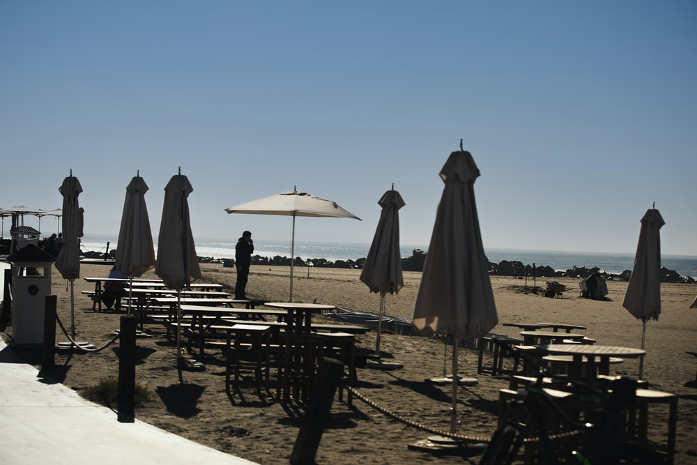 white patio umbrella on brown wooden table