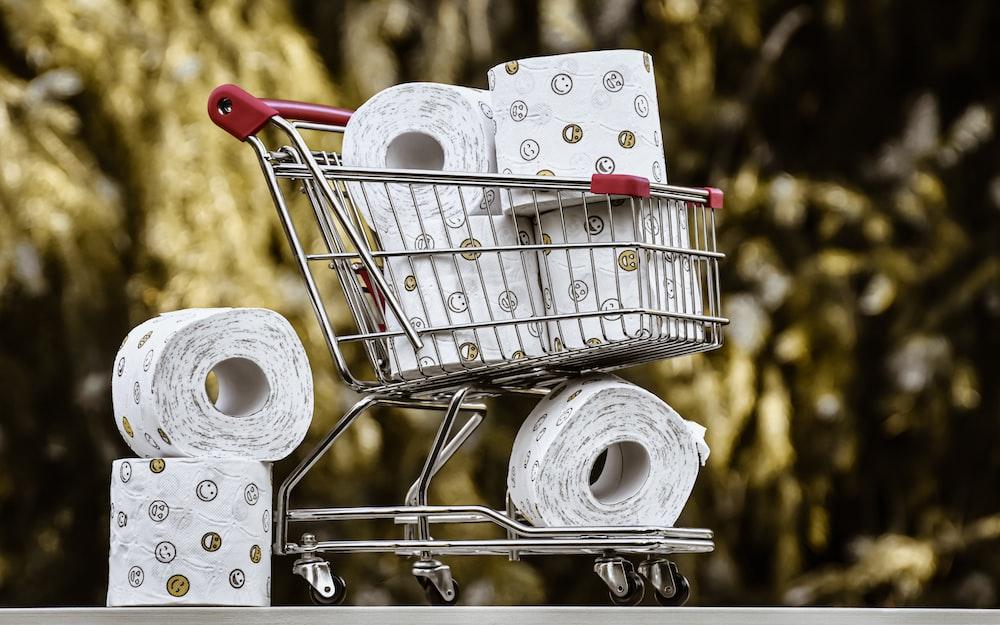 white tissue paper roll on stainless steel shopping cart