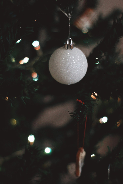 white christmas bauble on christmas tree