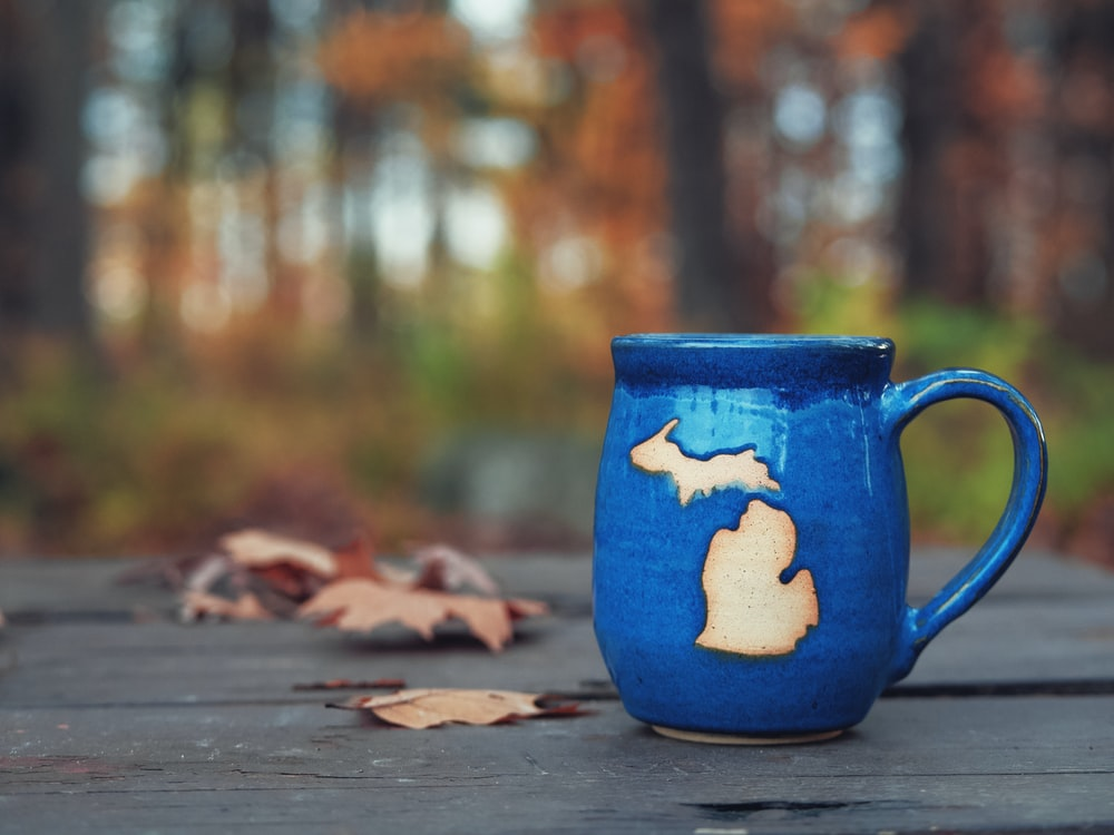 blue ceramic mug on brown wooden table