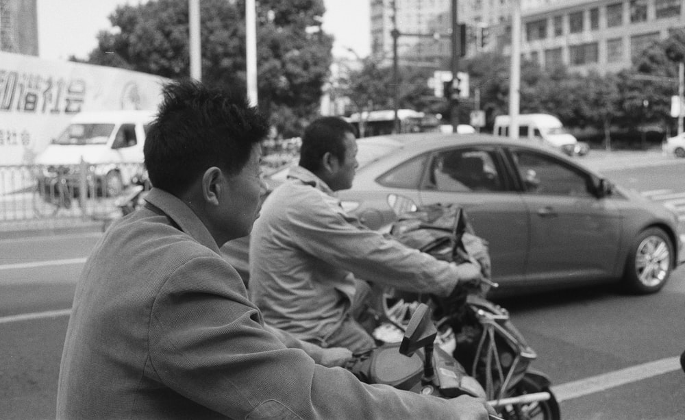 man in white long sleeve shirt sitting on motorcycle