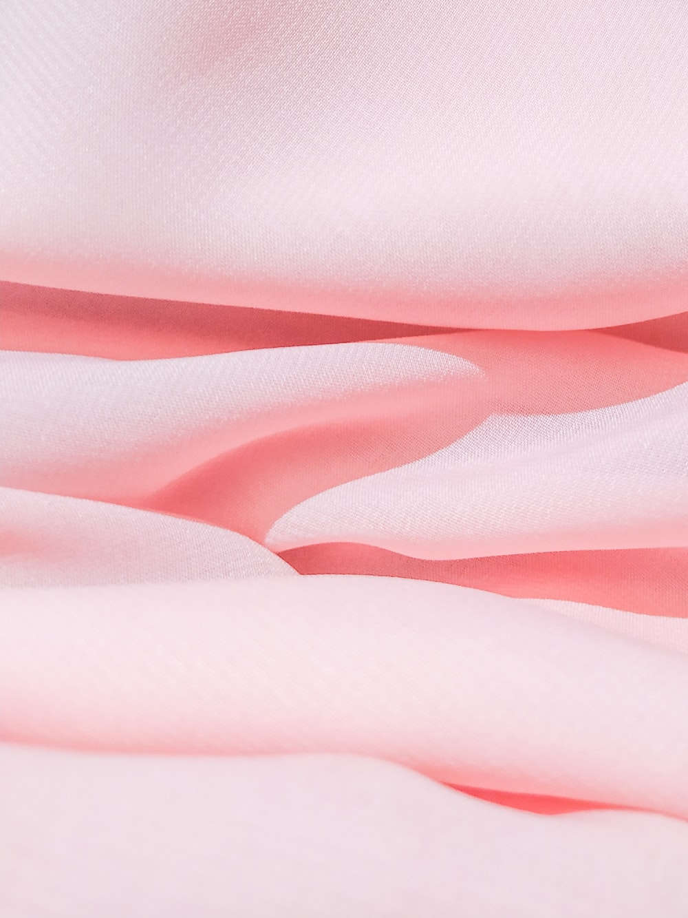 pink and white stripe textile