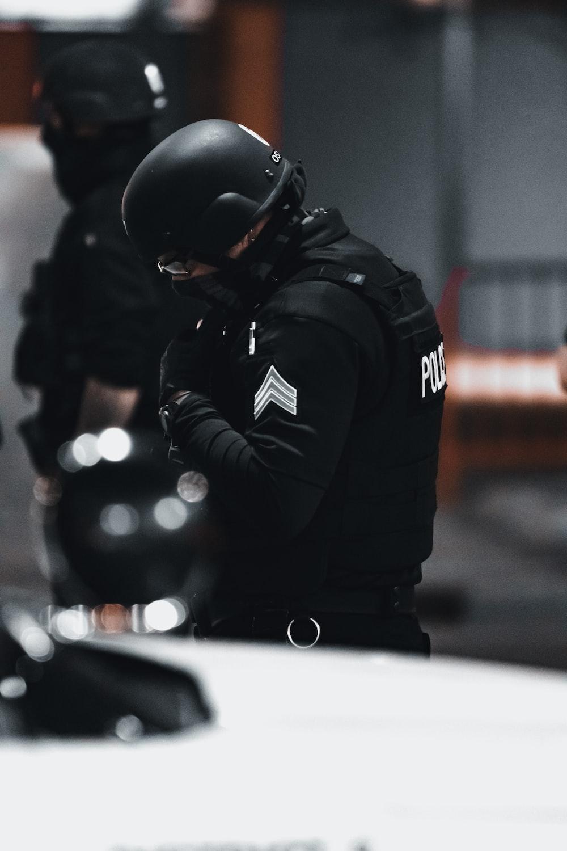 man in black jacket and helmet
