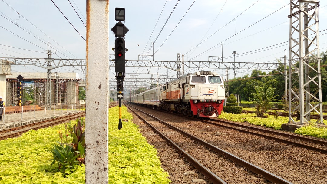 A Train with CC 206 Locomotive passing by Manggarai Station
