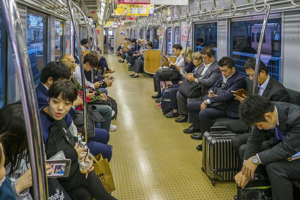 people sitting on black chair inside train