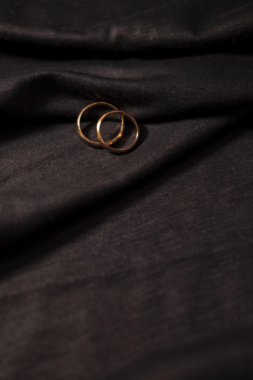 gold ring on black textile