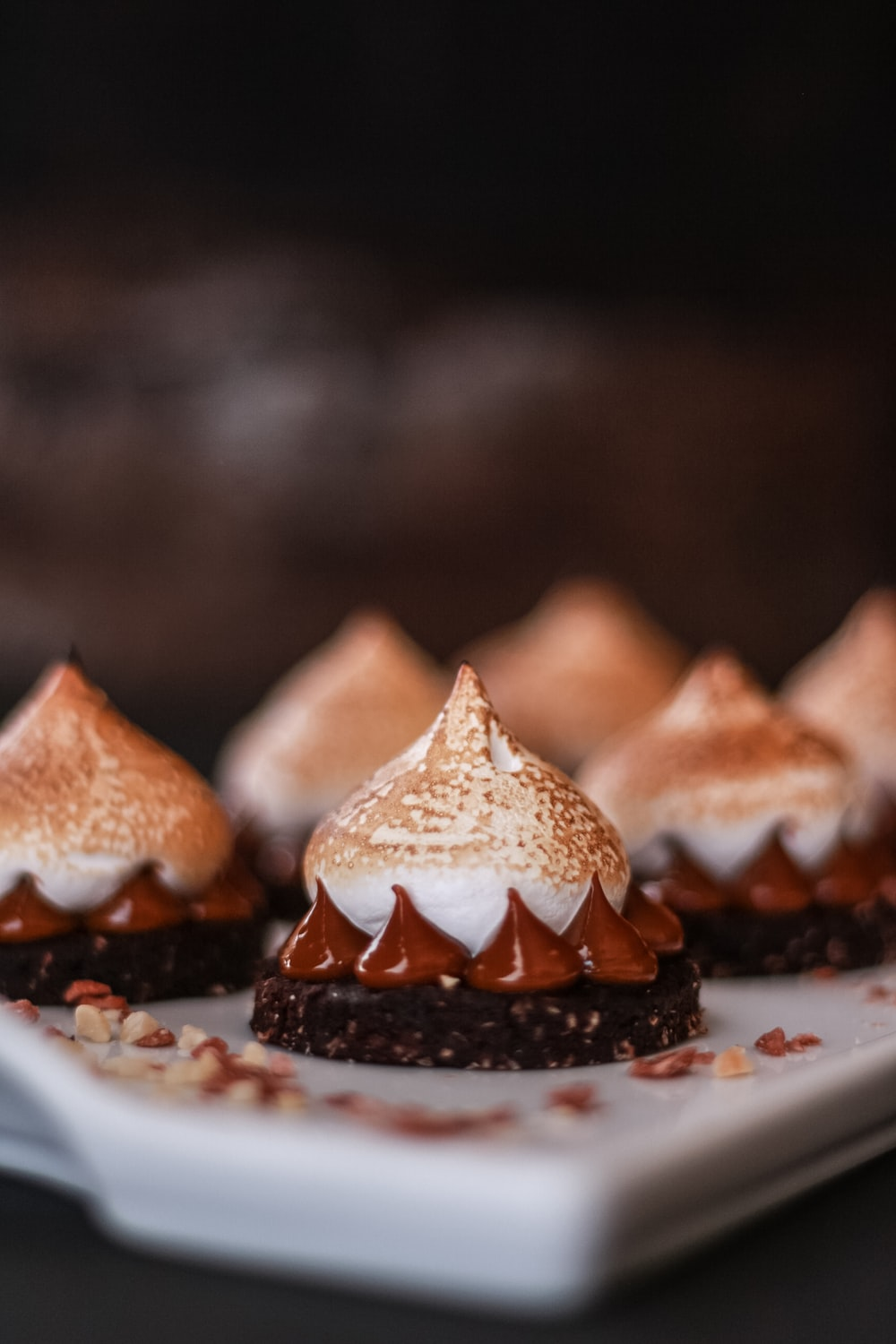 brown and white pastries on white ceramic plate