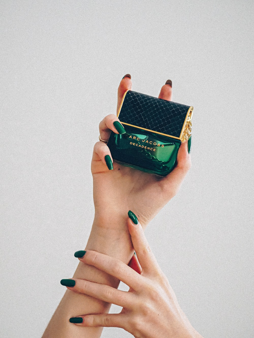 person holding green and yellow box