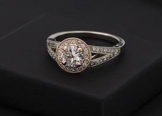 silver diamond ring on black box