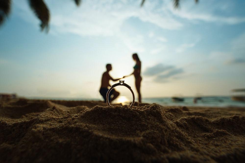 man riding bicycle on brown sand during daytime