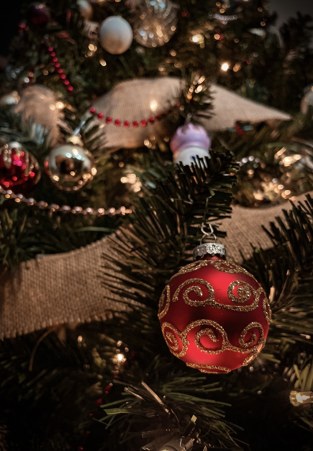 red and gold baubles on christmas tree