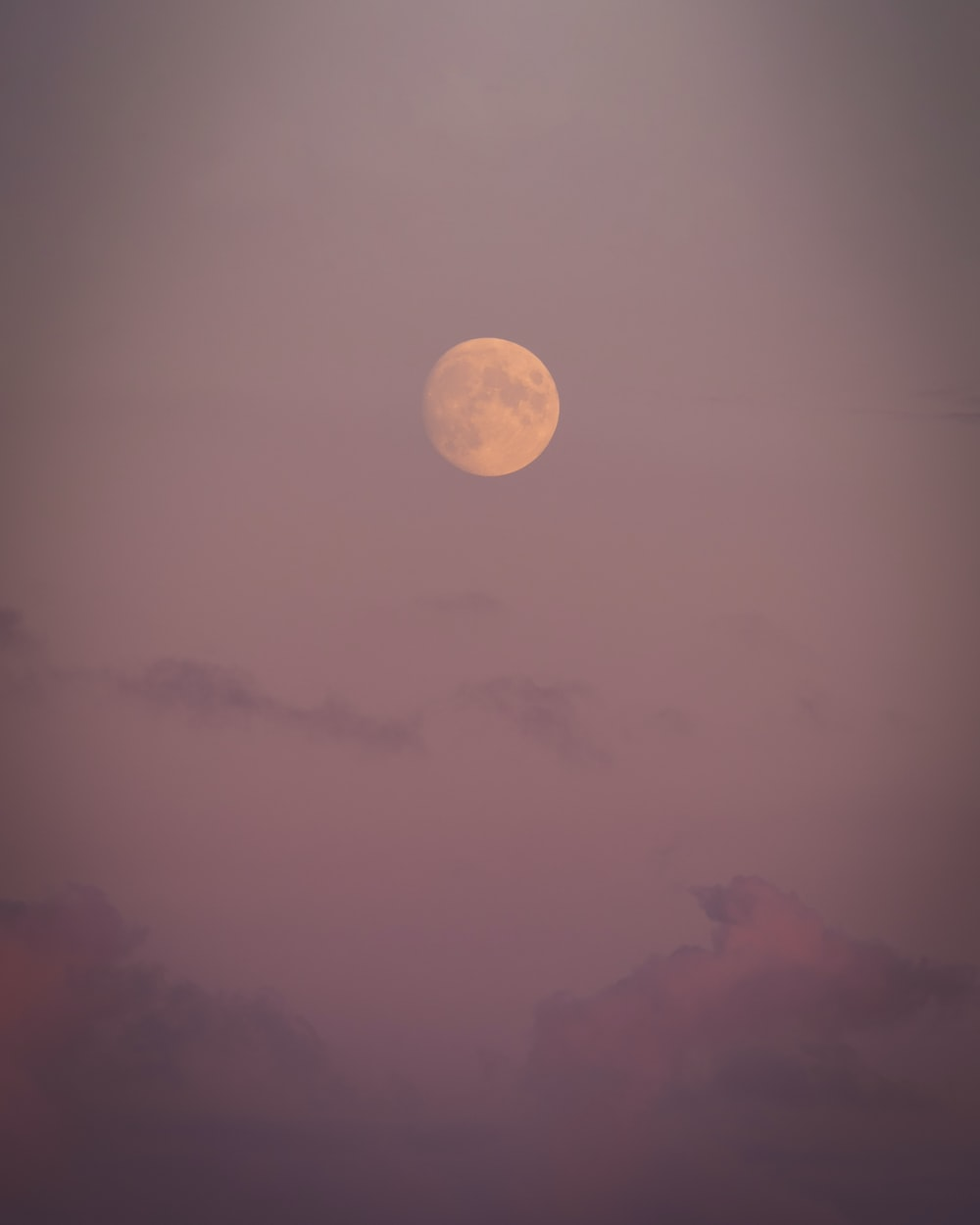 full moon over the clouds