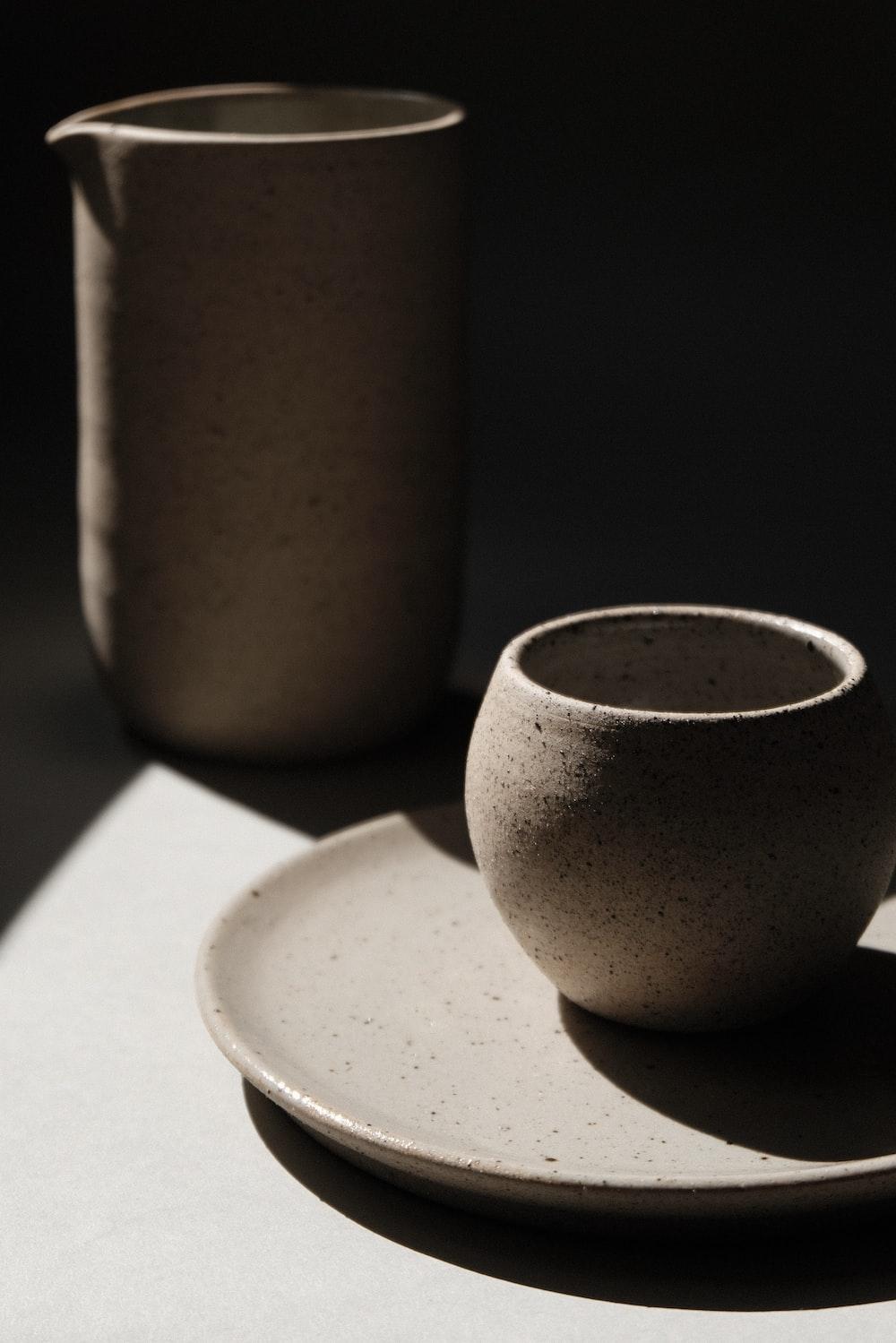 brown ceramic cup on white ceramic saucer