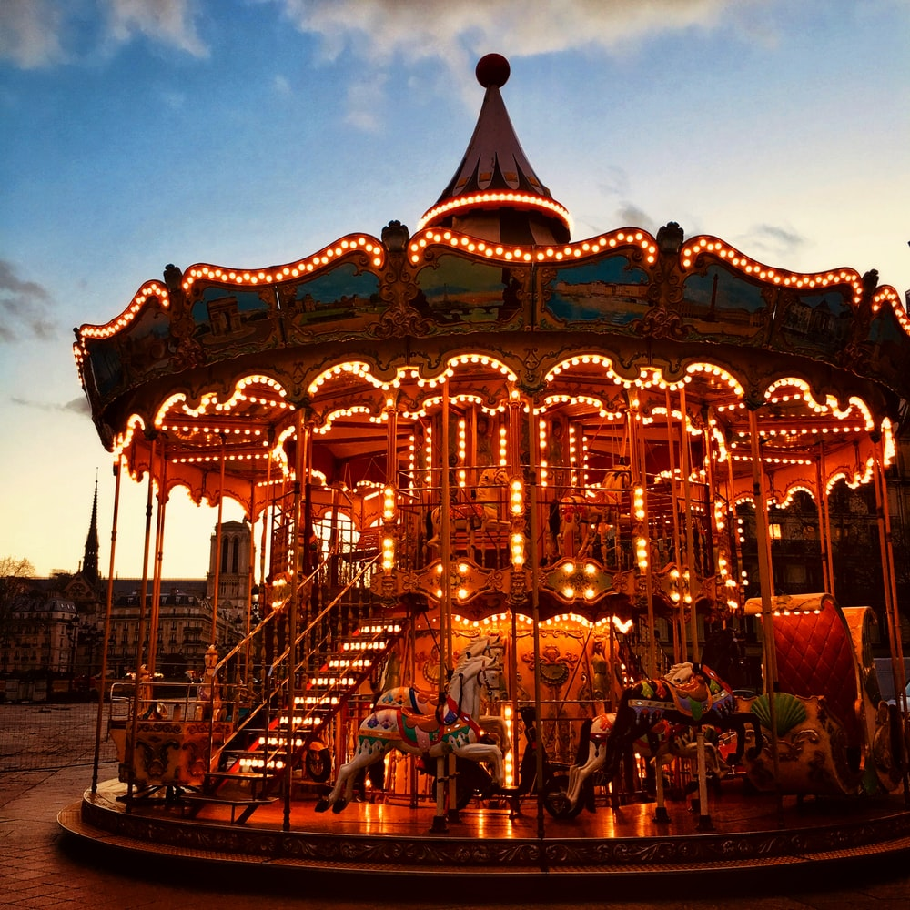 carousel with lights turned on during night time