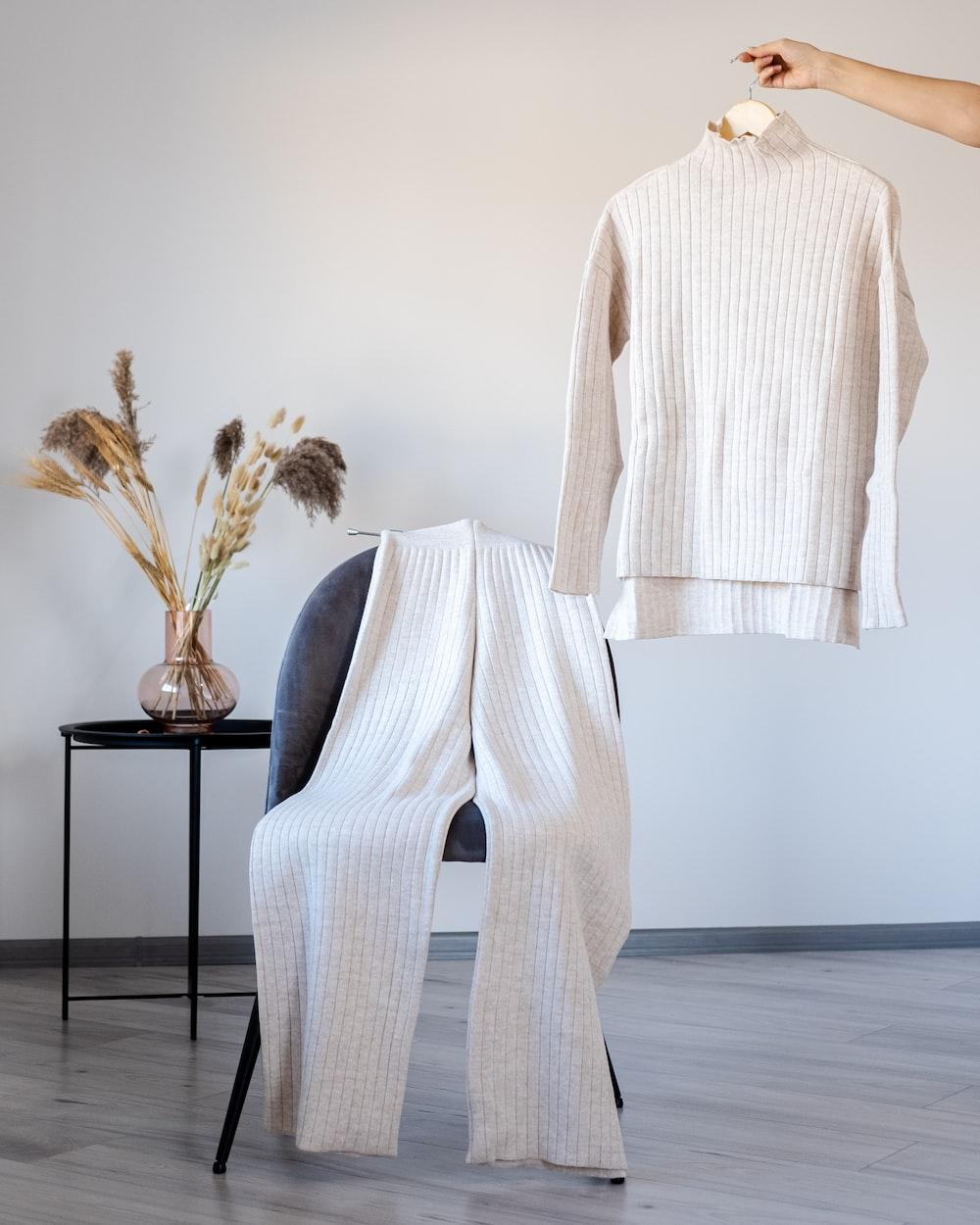 white long sleeve dress on black chair