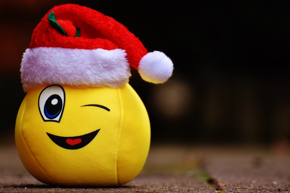 yellow and red plush toy