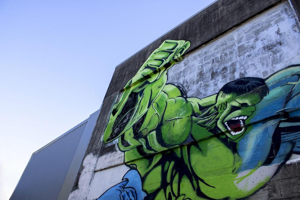 green and black dragon graffiti