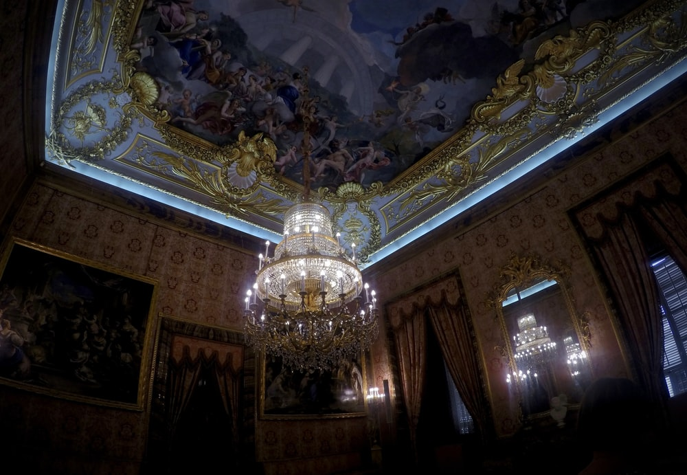 gold chandelier on white ceiling
