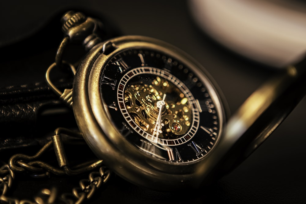 gold and silver round chronograph watch