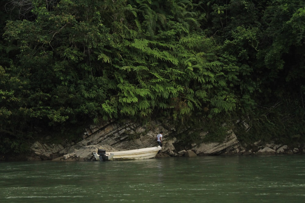 people riding on boat on river during daytime