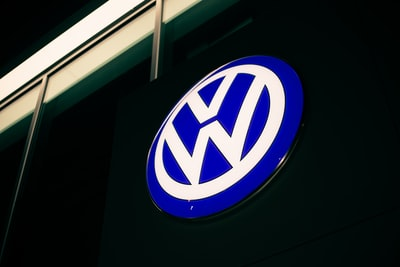 blue and white round b logo volkswagen zoom background