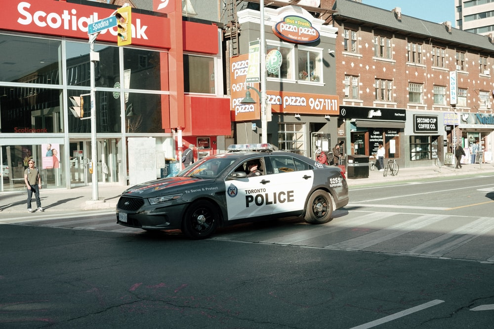black and white police car on road during daytime