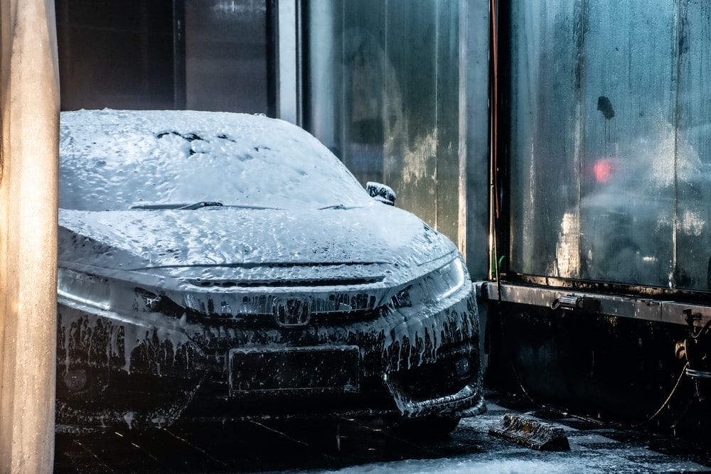 black car covered with snow