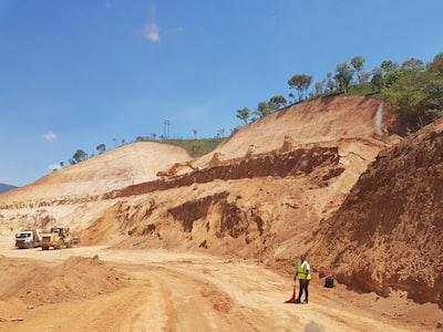 people walking on brown rock formation during daytime malawi teams background
