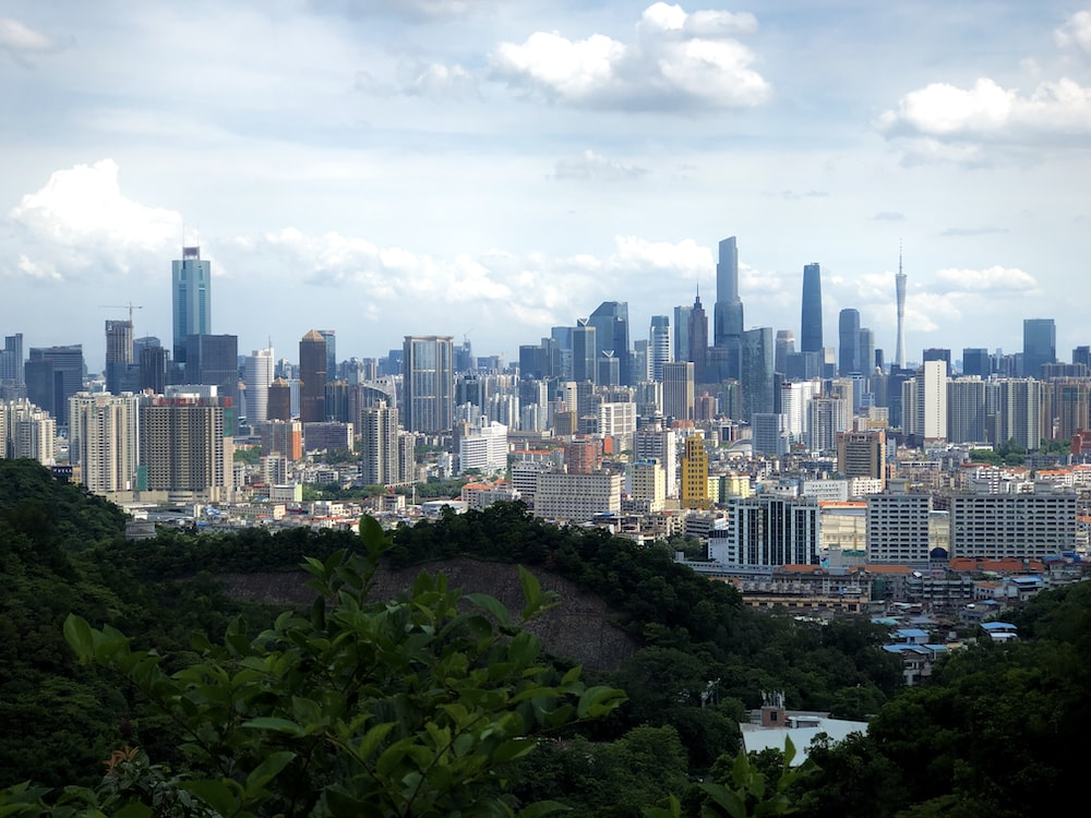 city skyline under white cloudy sky during daytime