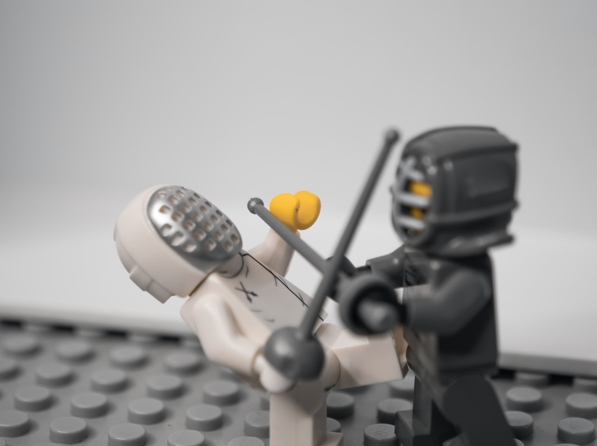 Fencer Lego figures fighting with swords