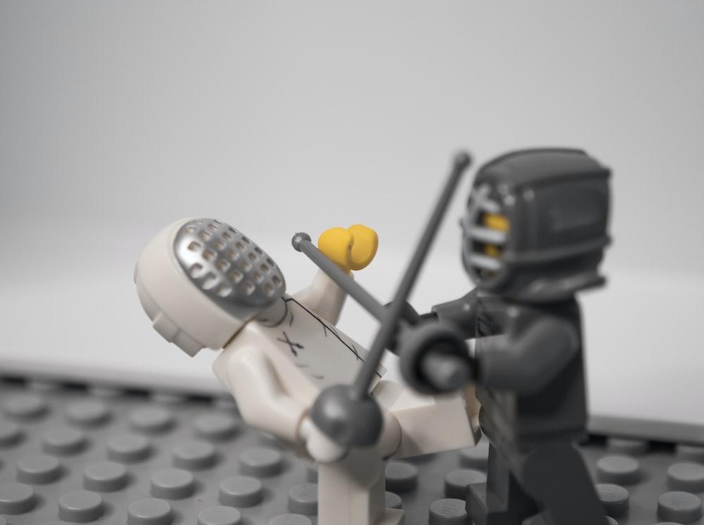 lego minifig holding black camera
