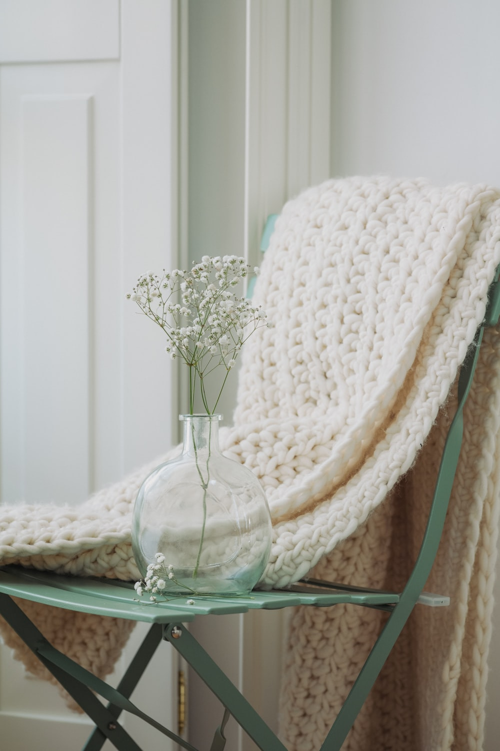 white and brown wicker chair