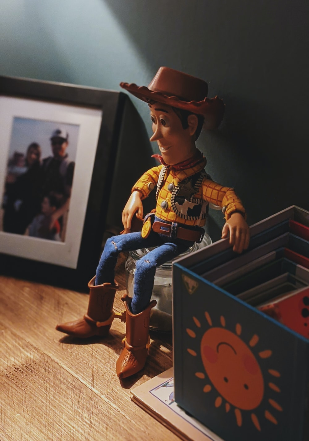 boy in cowboy costume standing on wooden box