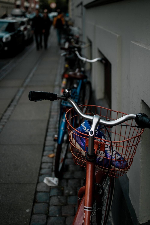 orange city bike with basket