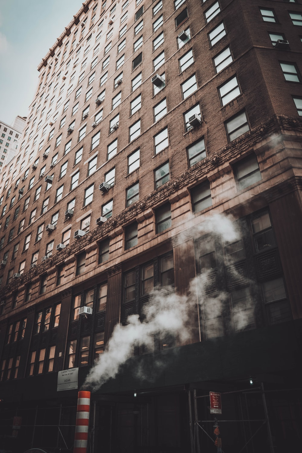 brown concrete building with smoke