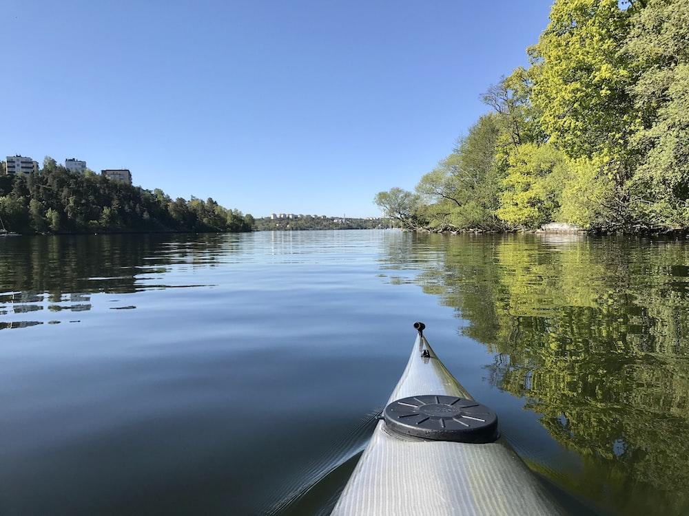 white boat on lake during daytime