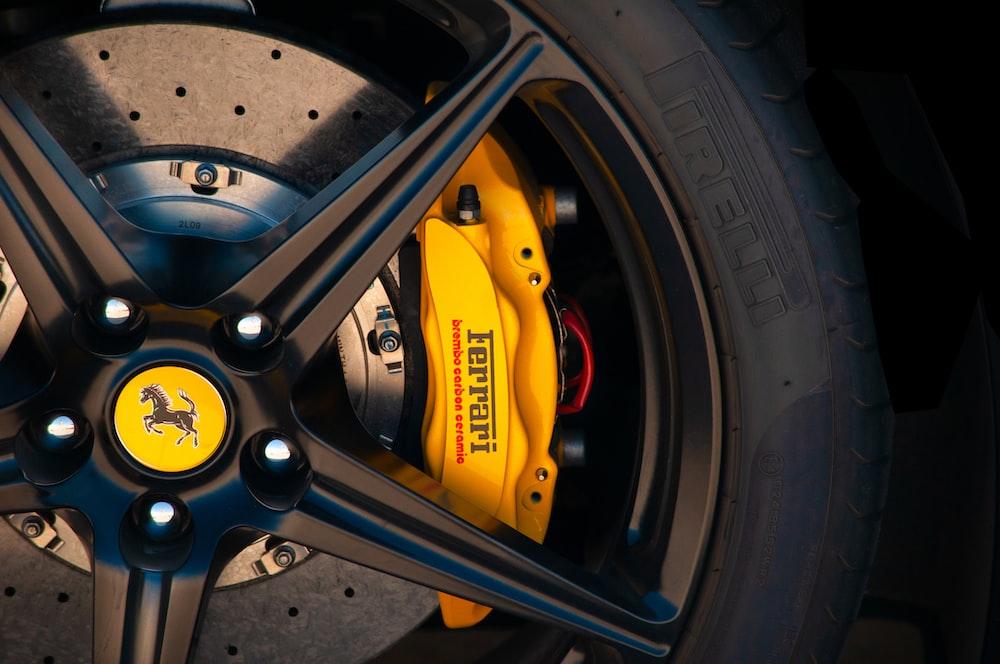 black and yellow car wheel