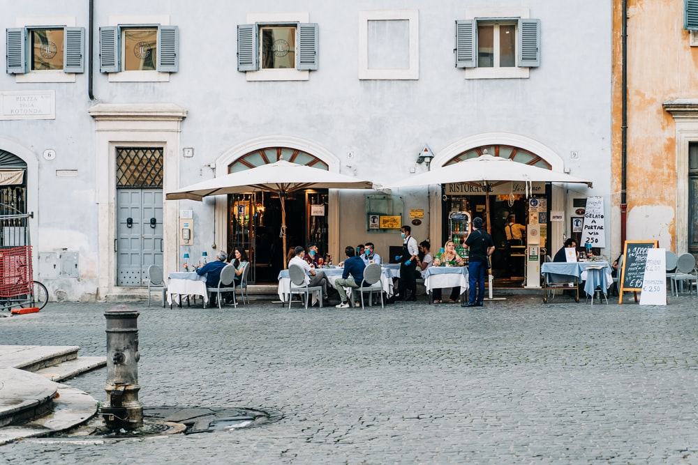 people sitting on chair near building during daytime