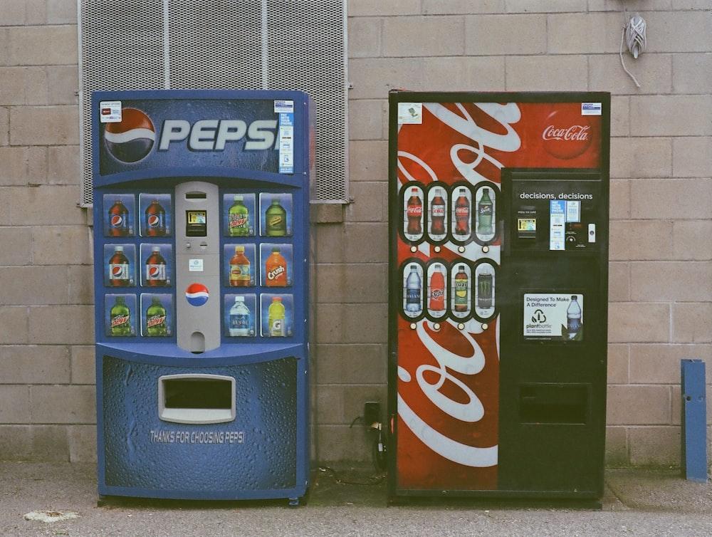 blue and white pepsi cola vending machine
