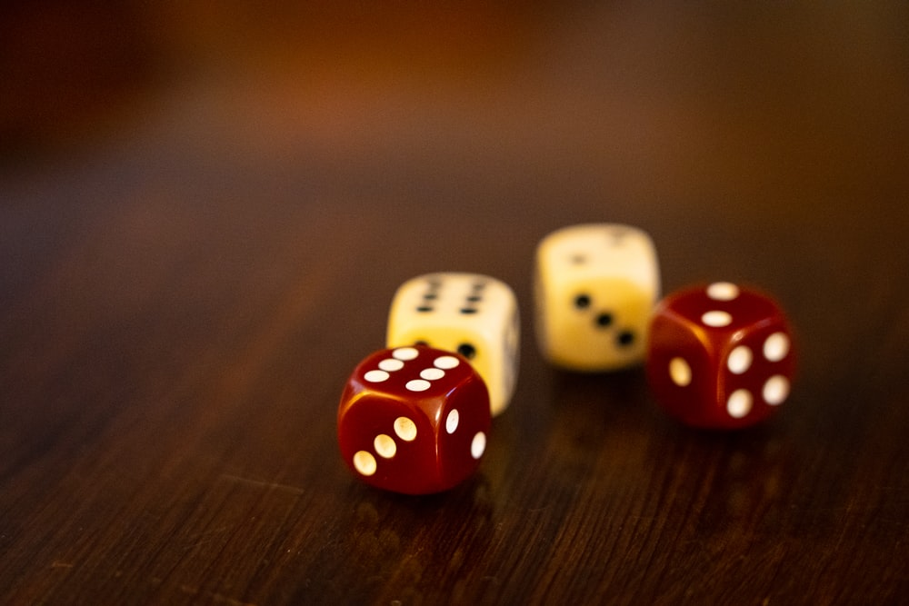 seven white and red dices on brown wooden table