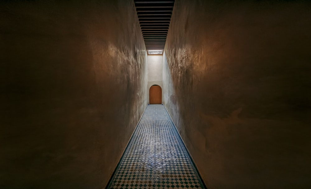 brown concrete tunnel with light