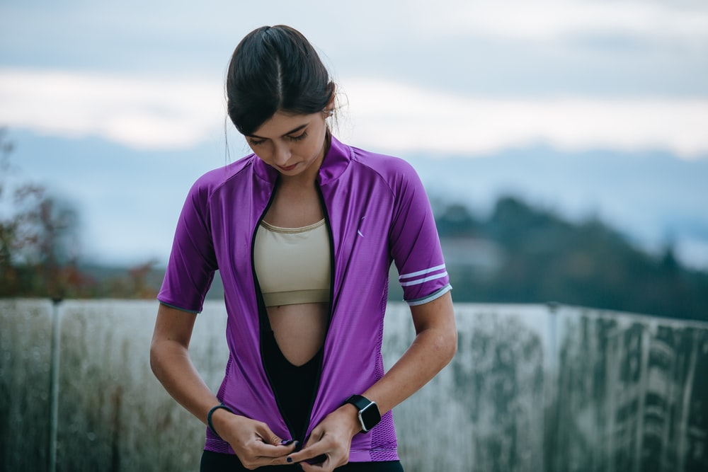 woman in purple shirt and white brassiere