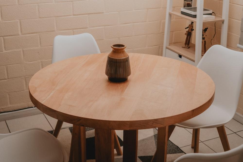 brown ceramic mug on round table