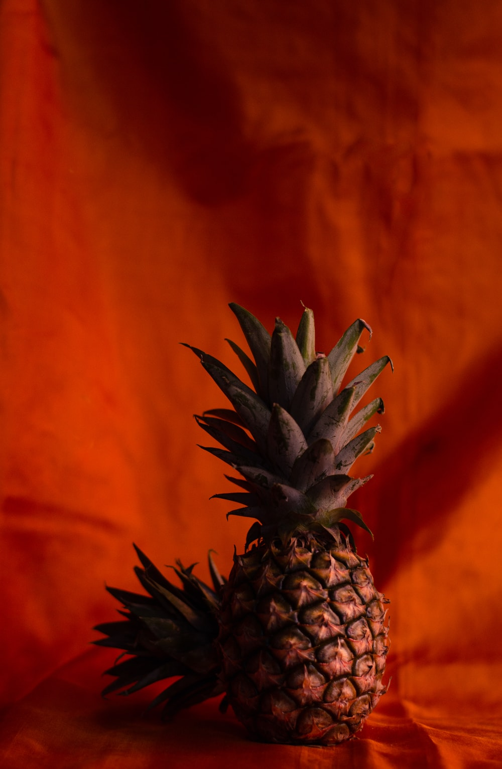 pineapple fruit on orange textile