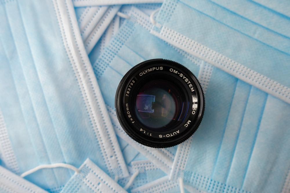 black camera lens on white and blue textile